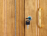 Wooden cupboard with lock and keys poster