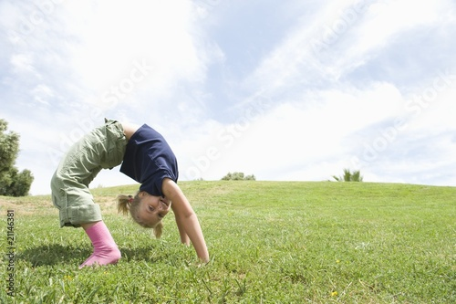 Bending over backwards, girl on grass