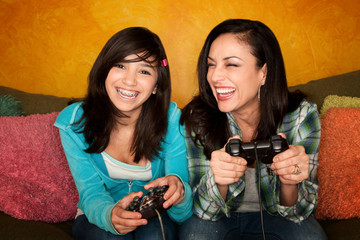 Hispanic Woman and Girl Playing Video game