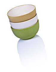 Three Stacked Colorful Bowls On Shiny White Table