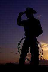 silhouette cowboy alone