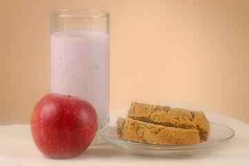 Home made bread, glass of yogurt and an apple