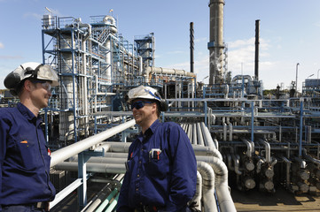 oil workers and power plant