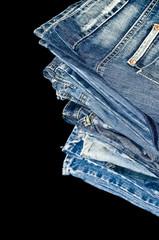 Blue denim jeans pile