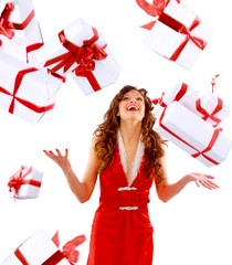 Excited attractive woman with many gift boxes and bags..