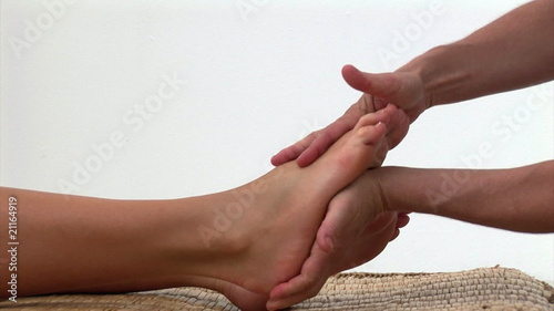 Portrait of a woman enjoying a foot massage in a spa center