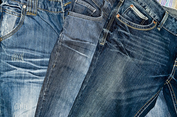 Pairs of Blue denim jeans