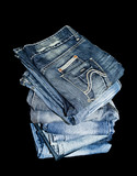 Pile of denim jeans