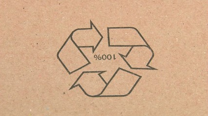 recycle pictogram on a cardboard box