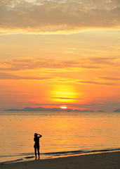 Thailand. Andaman sea. Phi Phi Magic sunrise and a girl