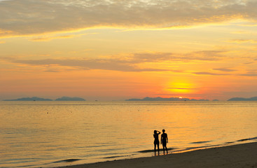 Thailand. Andaman sea. Phi Phi. Magic sunrise. Two girls