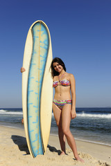 attractive sufer girl holding her board