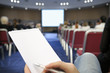 Blank Notebook against the background of conference.