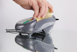 Swiping a credit or debit card through a transaction terminal poster