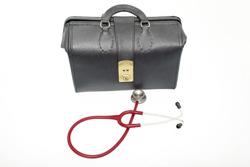 A leather medical bag next to a stethoscope.