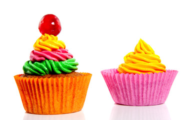 two colorful creamed cupcakes isolated over white