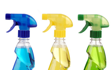 Transparent spray bottles on white background
