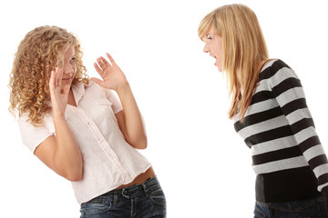 Two teen girls having an argue