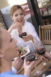 Beautiful woman drinking wine with her friends