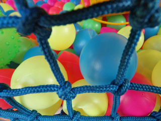 many colorful balls in children playground