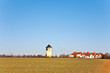 old Water tower in beautiful landscape with blue sky
