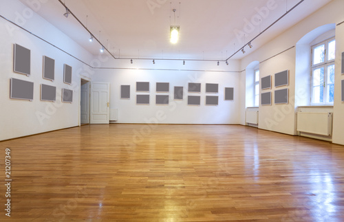Empty art gallery with blank pictures