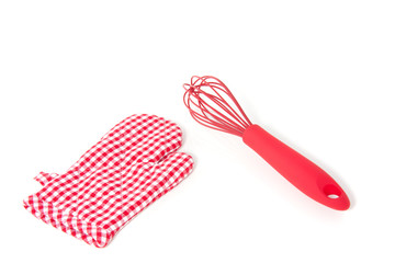 a whisk and a checkered kitchen glove isolated over white