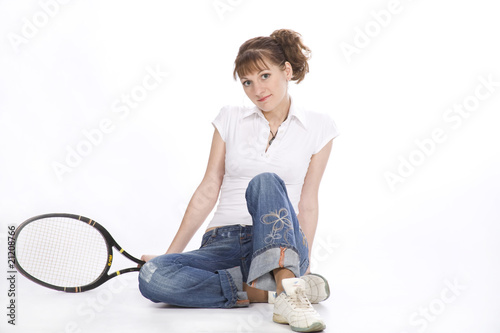 The girl with a tennis racket.