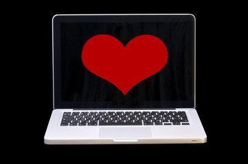 Notebook with heart on monitor