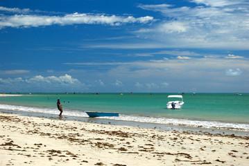 Fisherman in a crystalline green sea in Alagoas, Brazil