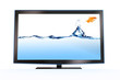 goldfish leaping out of a stylish lcd tv