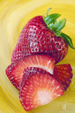 Beautiful red fresh strawberries on colorful yellow plate