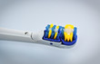 electric toothbrush head on grey background
