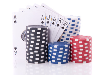 gambling cards and chips for casino games isolated over white