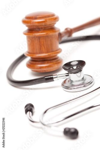 Black Stethoscope and Gavel on White