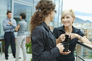Businesswomen talking outdoor