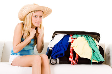 Girl near overstuffed suitcase