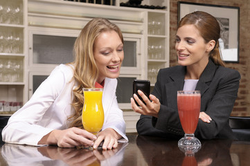 Girl showing sms to her friend