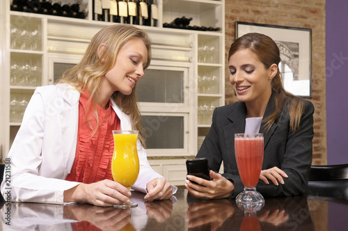 Girlfriends drinking healthy coctails Poster