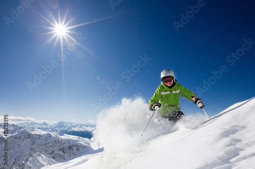 Happy female skier with mountain view