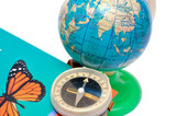The globe the book and compass for geography lesson poster