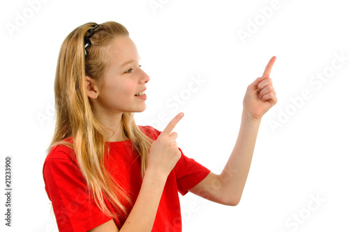 Girl points to something over white background
