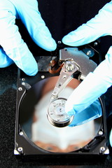 Lab technician performing quality inspection on Hard Drive