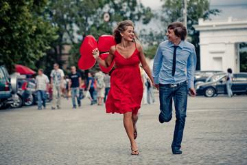 Running teenage couple