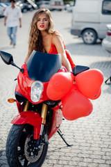 Fashion model on motorcycle
