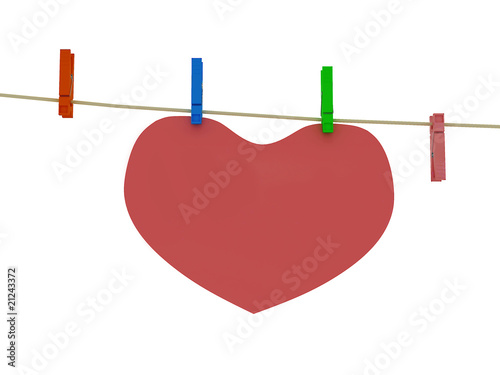 Heart on clothes peg isolated on white