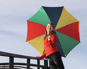 Happy girl with umbrella