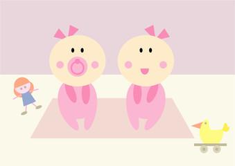 Zwillings-Babies (Mädchen) beim Spielen