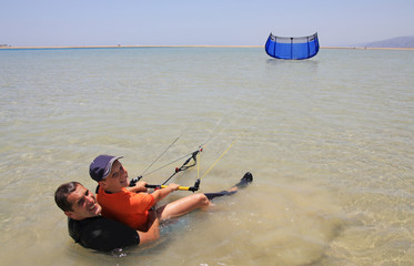 Kitesurfing. Father and son.