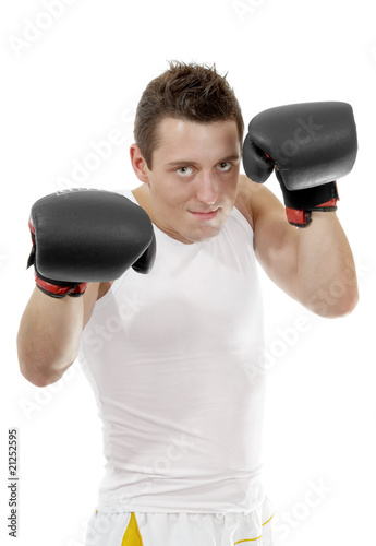 Proud boxer with boxing gloves after the fight